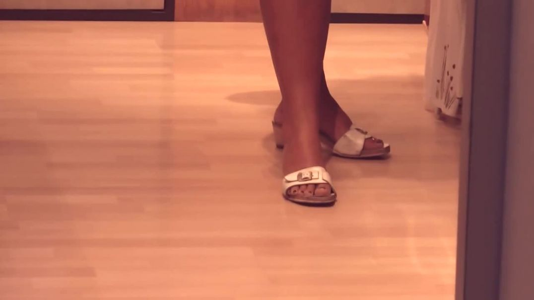 Indoor Candid - Mature woman in white sandals typ scholls in the shop