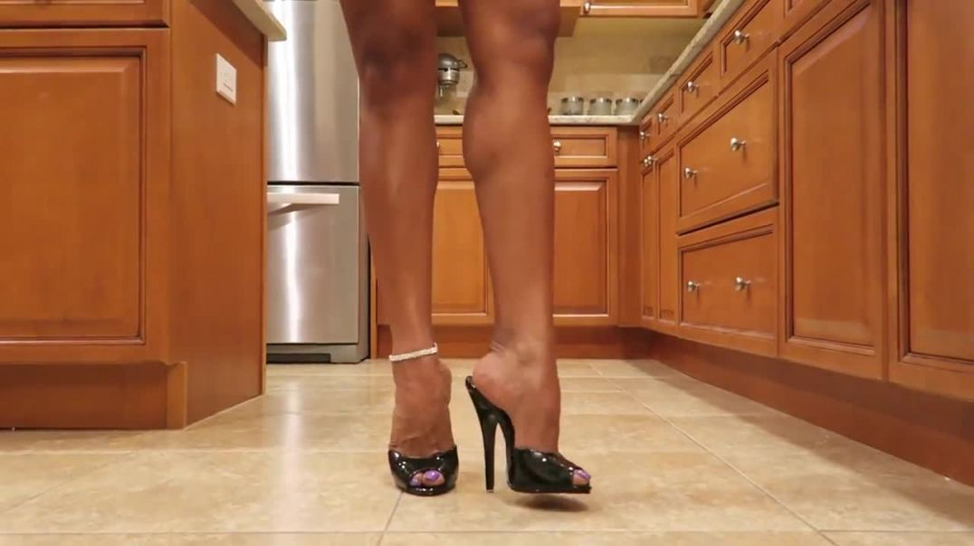 Mules high heels in the kitchen
