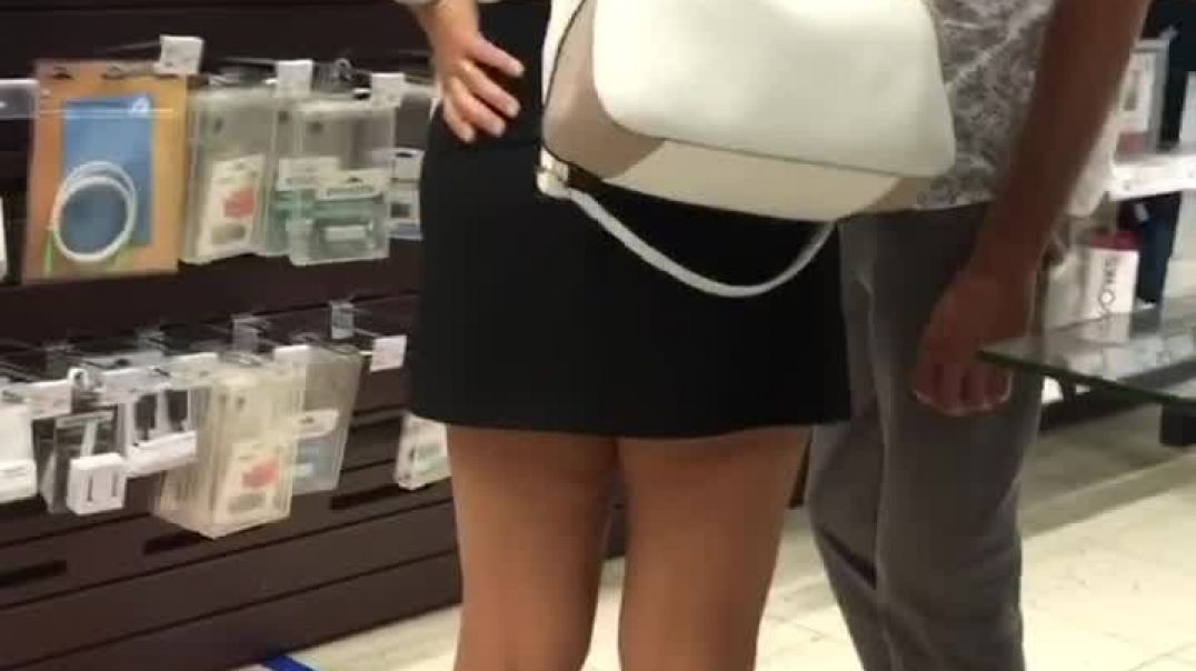 candid blond milf shopping in black mini skirt and High heels