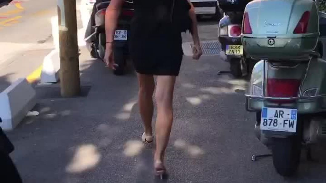 Candid blond walking with sexy black skirt ans white kitten heels