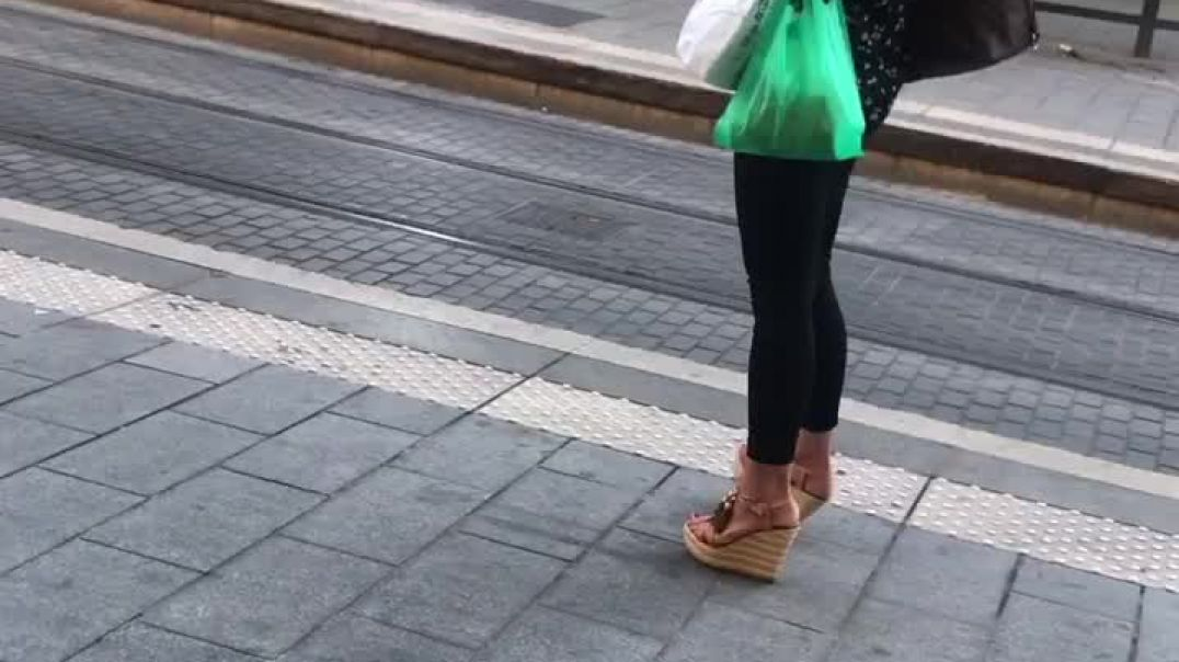 Very hot young woman in sexy wedges