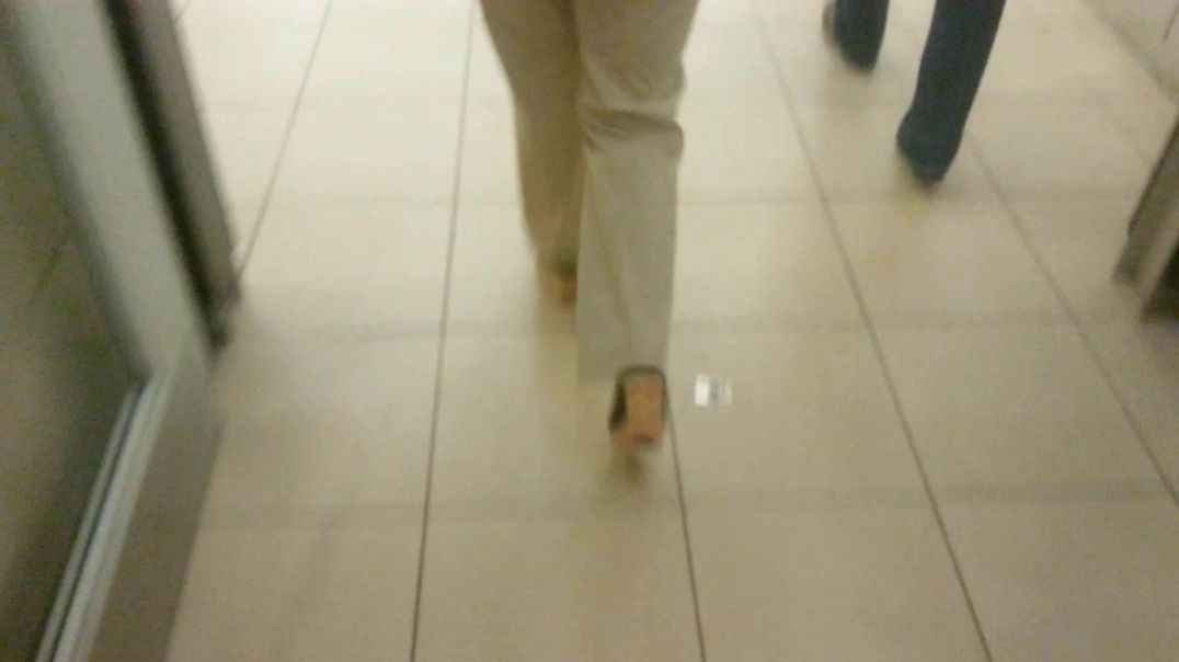 Walking in shopping mall with wedge mules