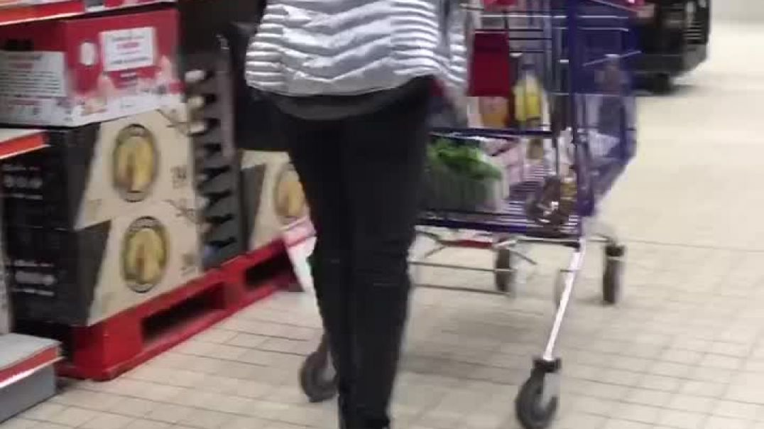 Sexy blond milf shopping with high heel boots