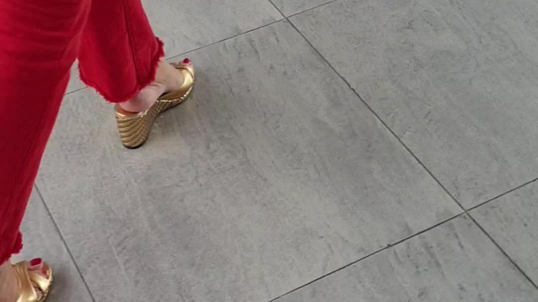 my wife walking on her golden wedge jimmy choo mules