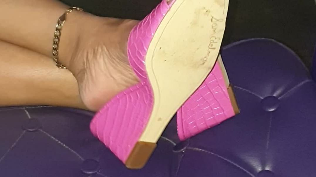 my wife playing with her new pink wedge mules