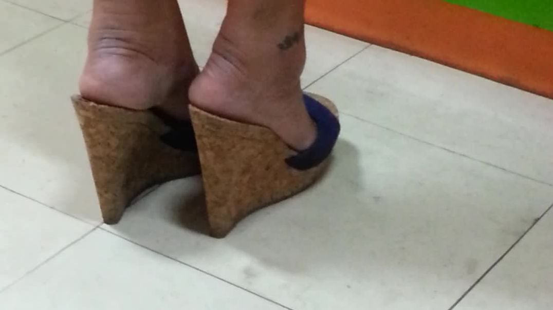 my wife wearing her jessica simpson wedges when  we go for shopping