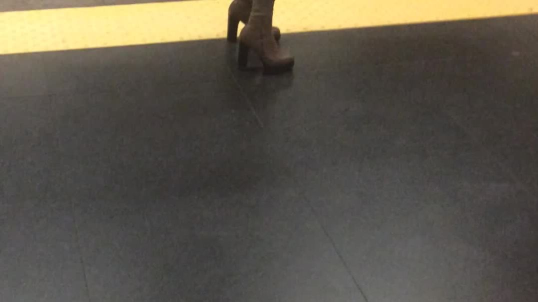 Candid high boot waiting for the subway