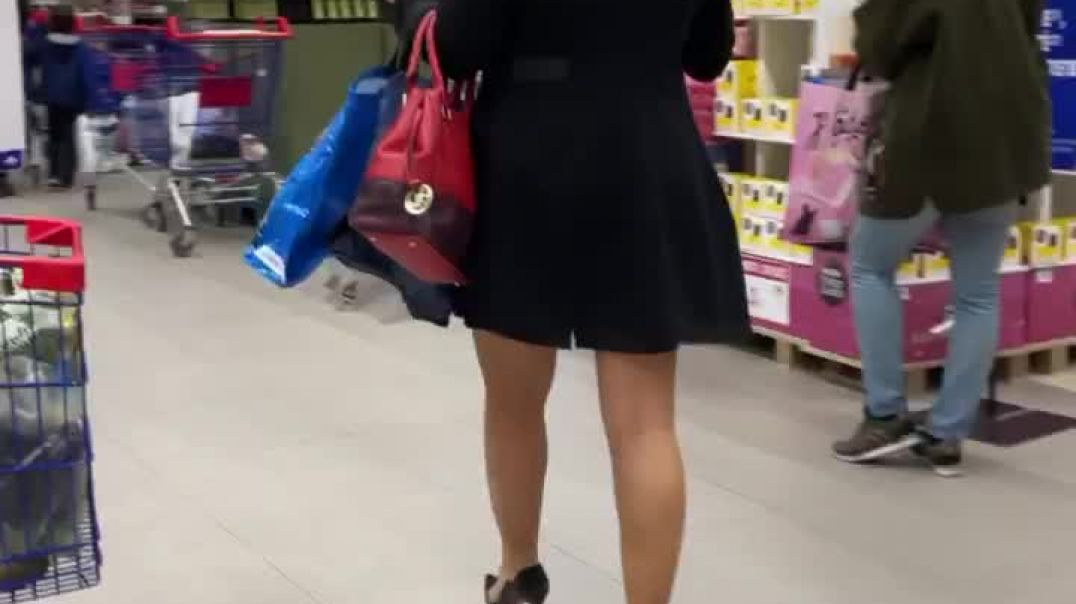 Amazing sexy blond in black skirt and louboutin high heels