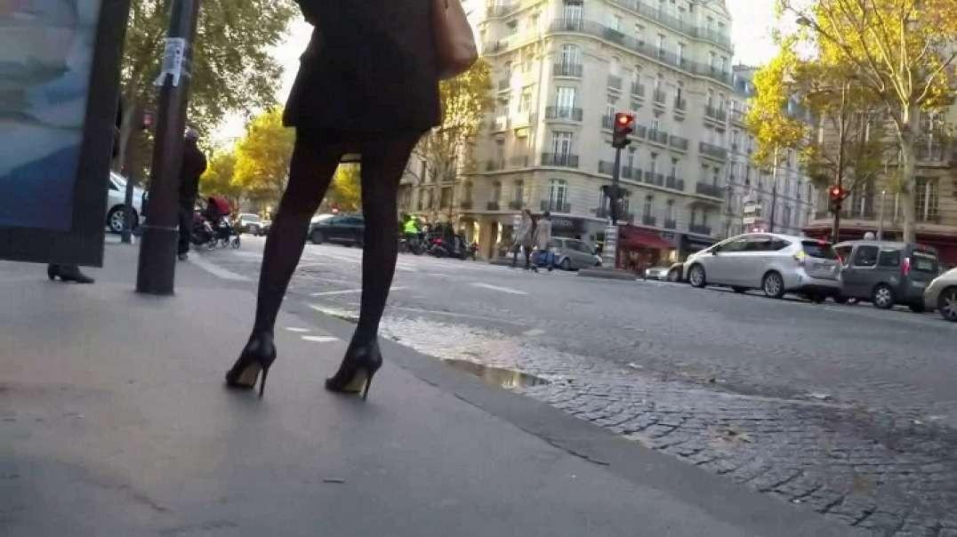 Black in mini skirt pantyhose and high heels