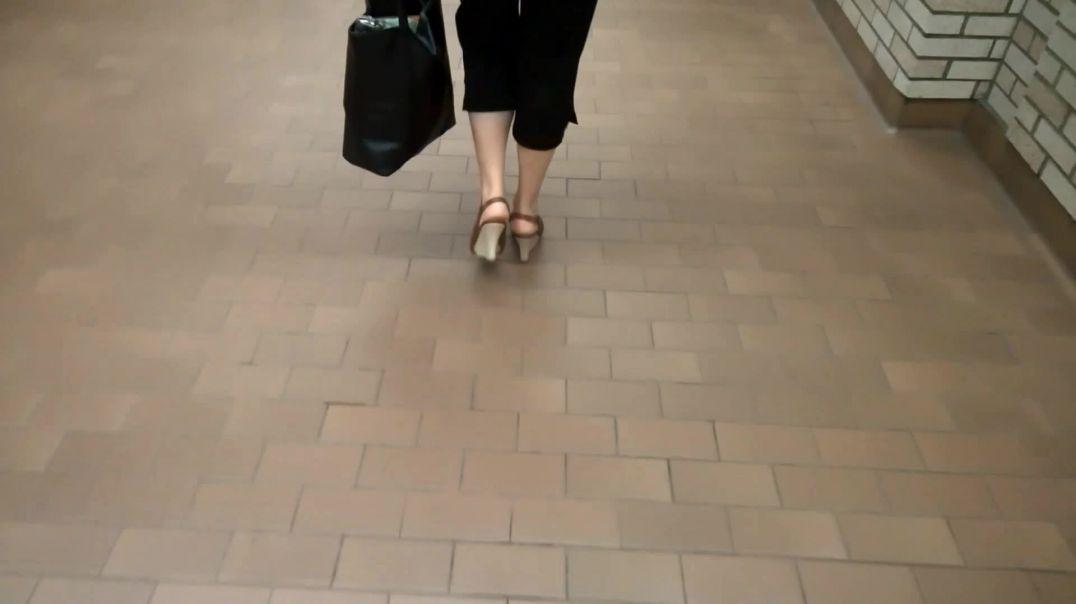 Woman walking in wedge slingbacks