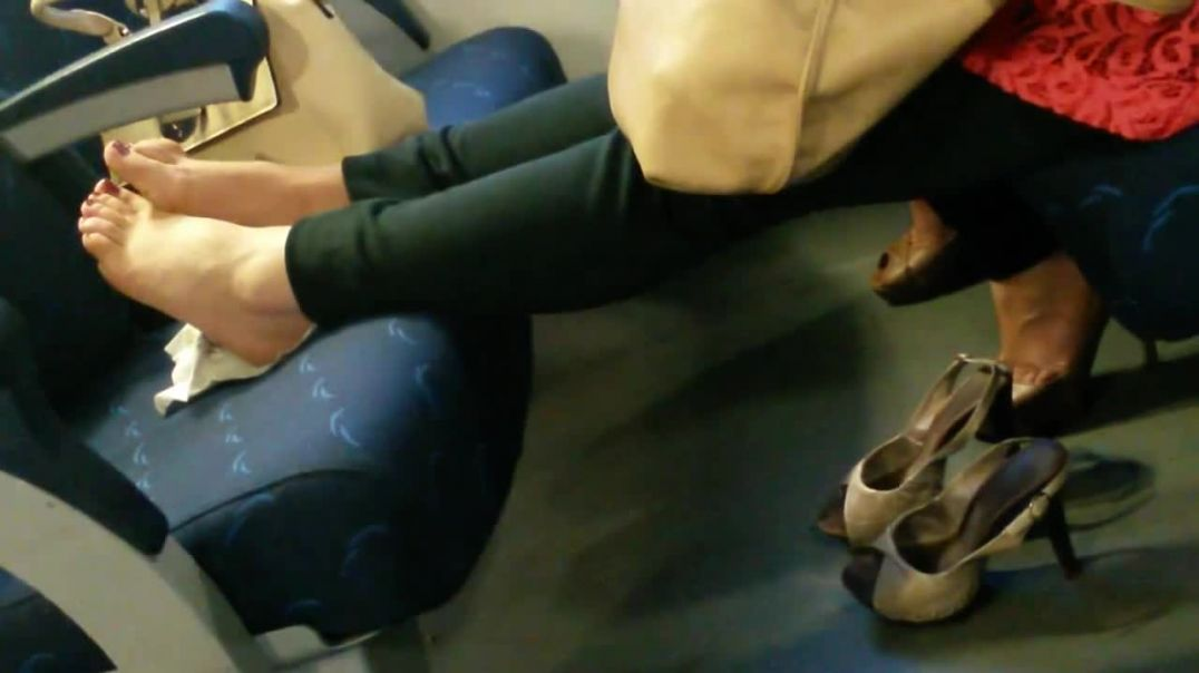 Nice Lady  in slingbacks pumping feet on train