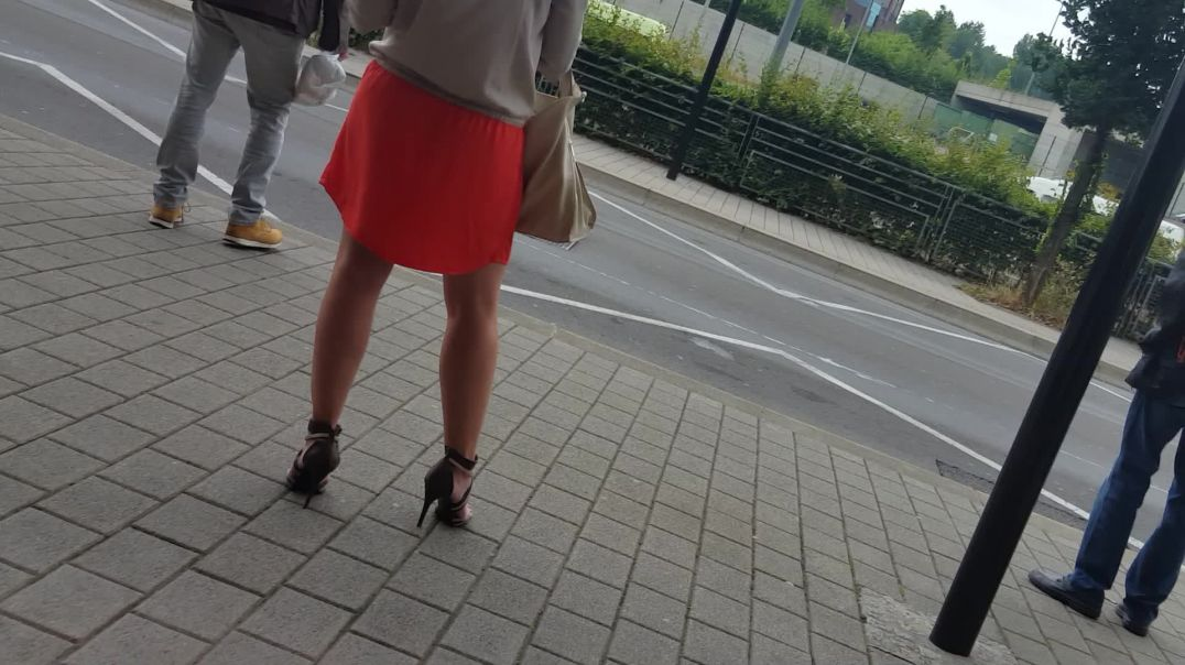 Lady in sexy heels at the busstop