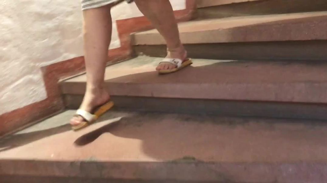 Walking down a stairs in wooden sandals