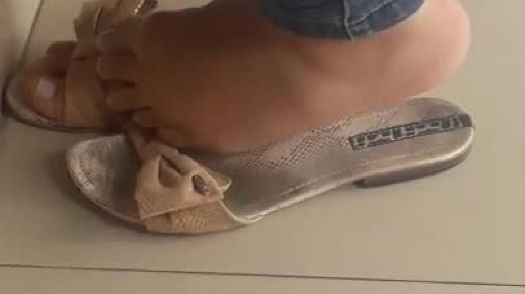 Candid feet in flat mules