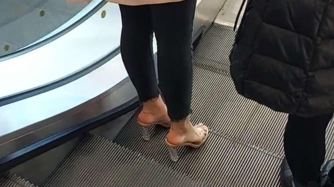 Beautiful feet in clear heels