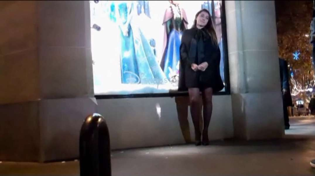 Pretty Brunette in mini dress and green high heels