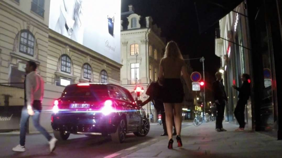 Pretty Blonde in black mini skirt and high heels louboutins