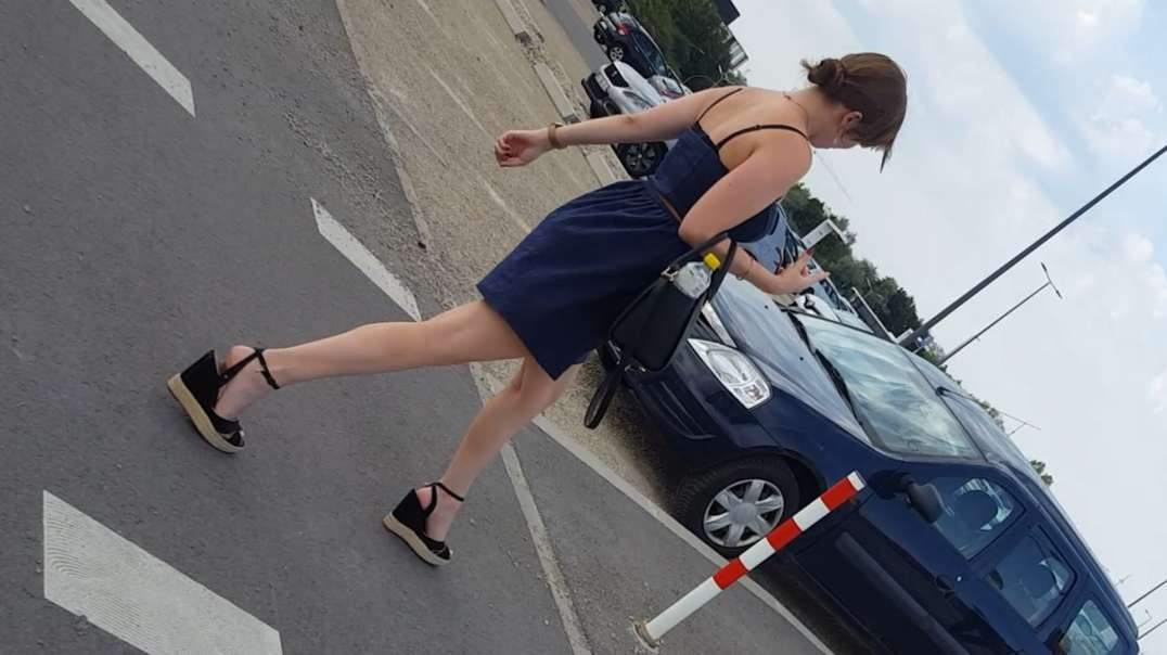 Young lady with black wedges