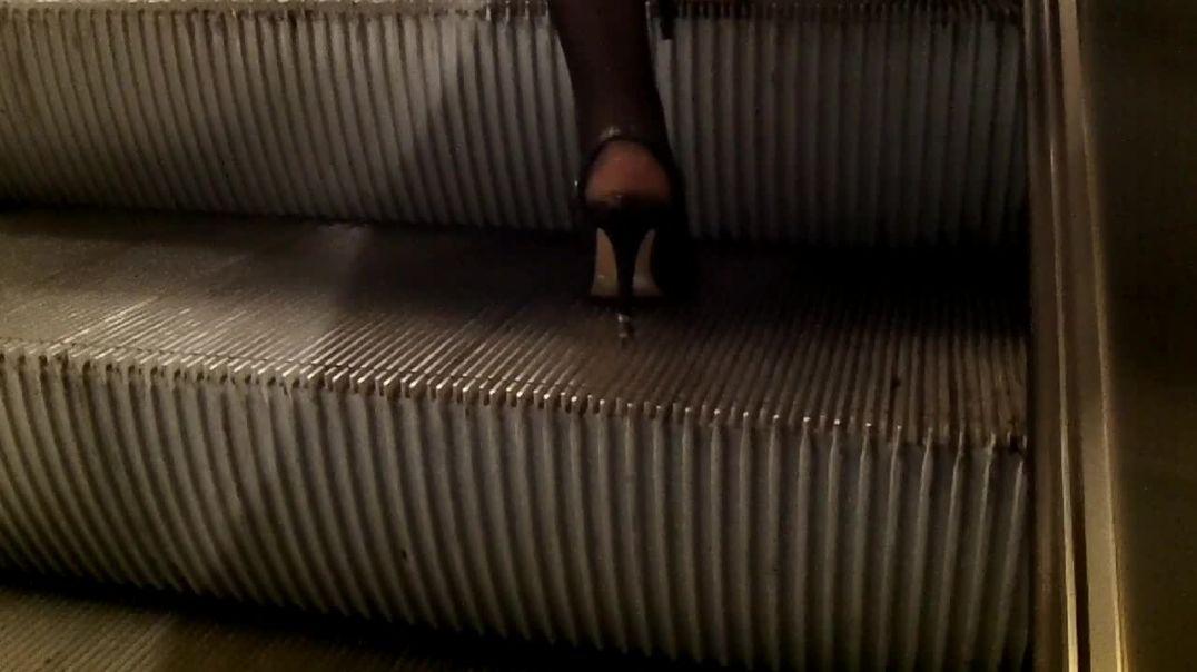 high heels sandals in escalator