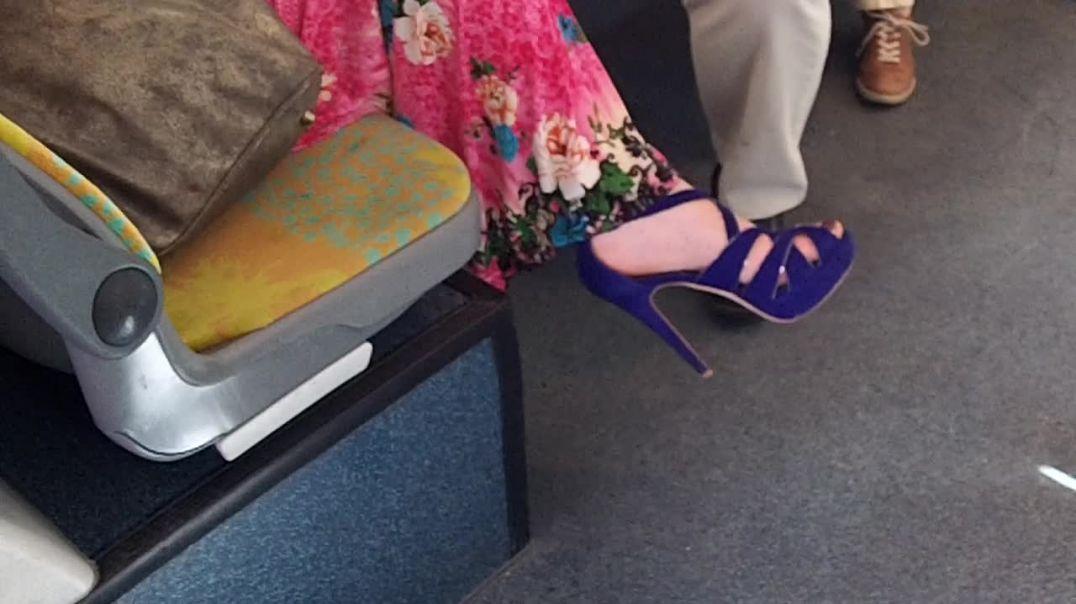 purple platform sandals in bus