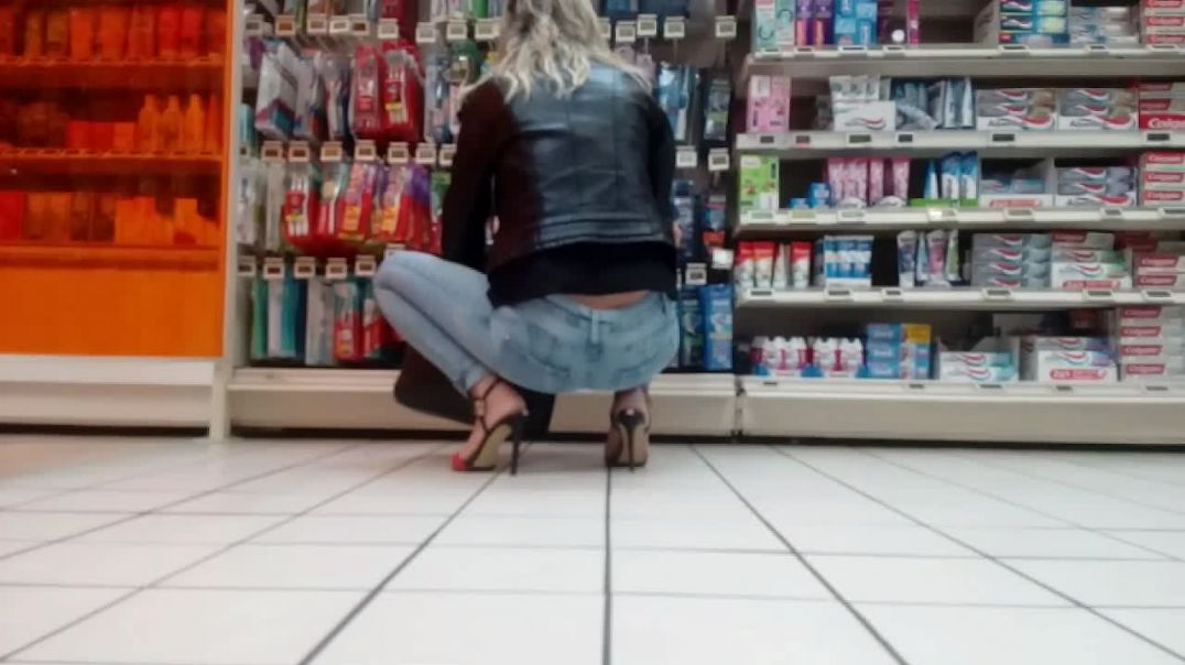 sexy jeans and high heels at supermarket