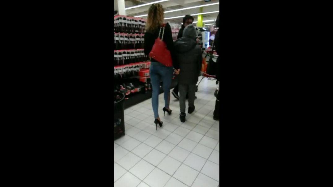 blond in platform high heels at supermarket