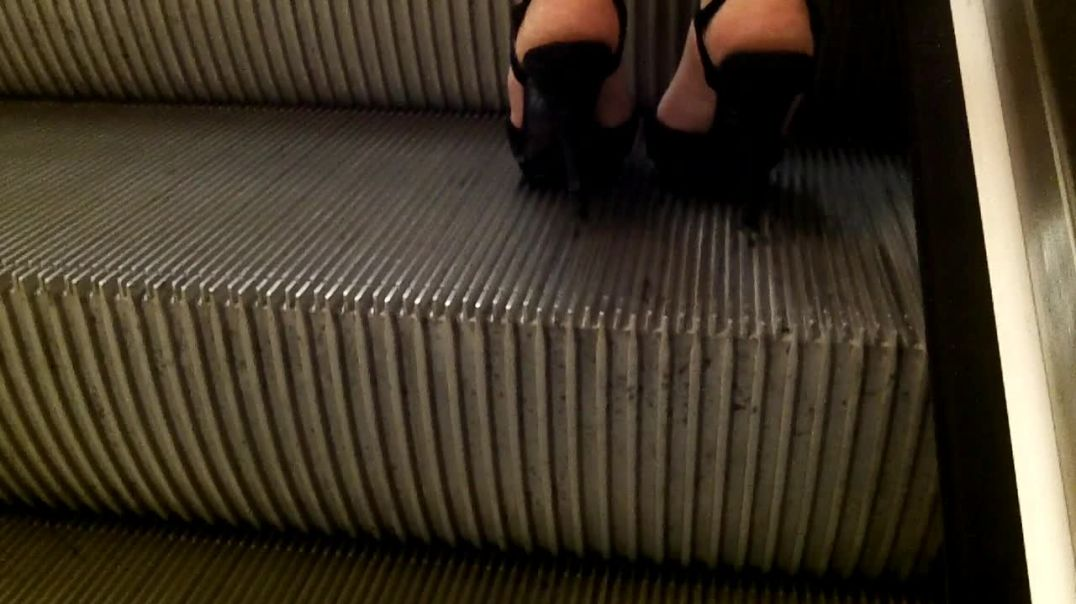 black high heels sandals escalator