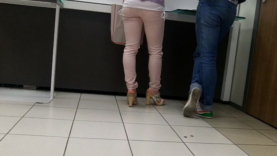 pink pants and high heels wooden mules