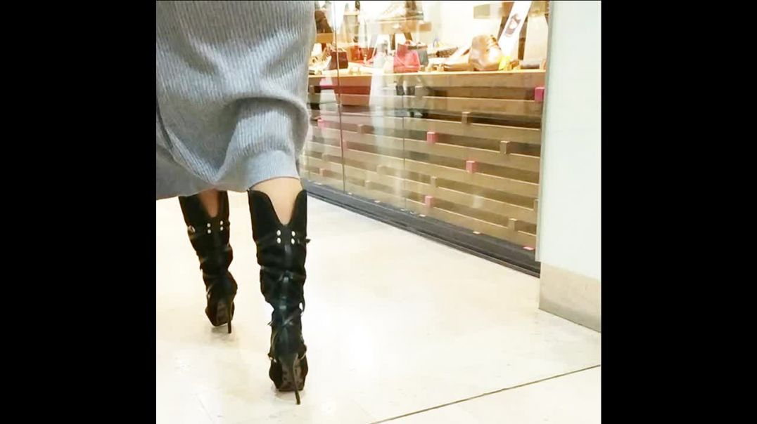 very high heels boots in shopping center