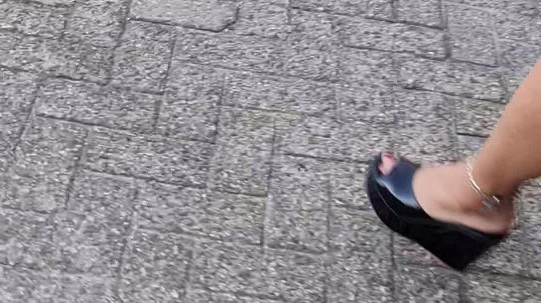 my wife wearing her black sergio rossi wedge mules