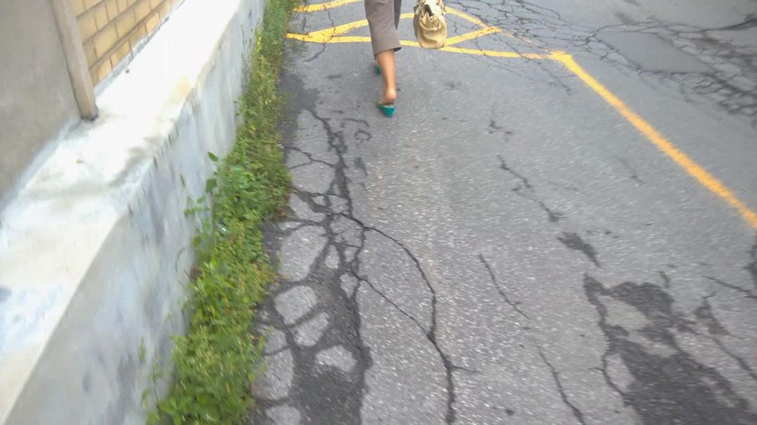 Woman slapping in her teal wedges
