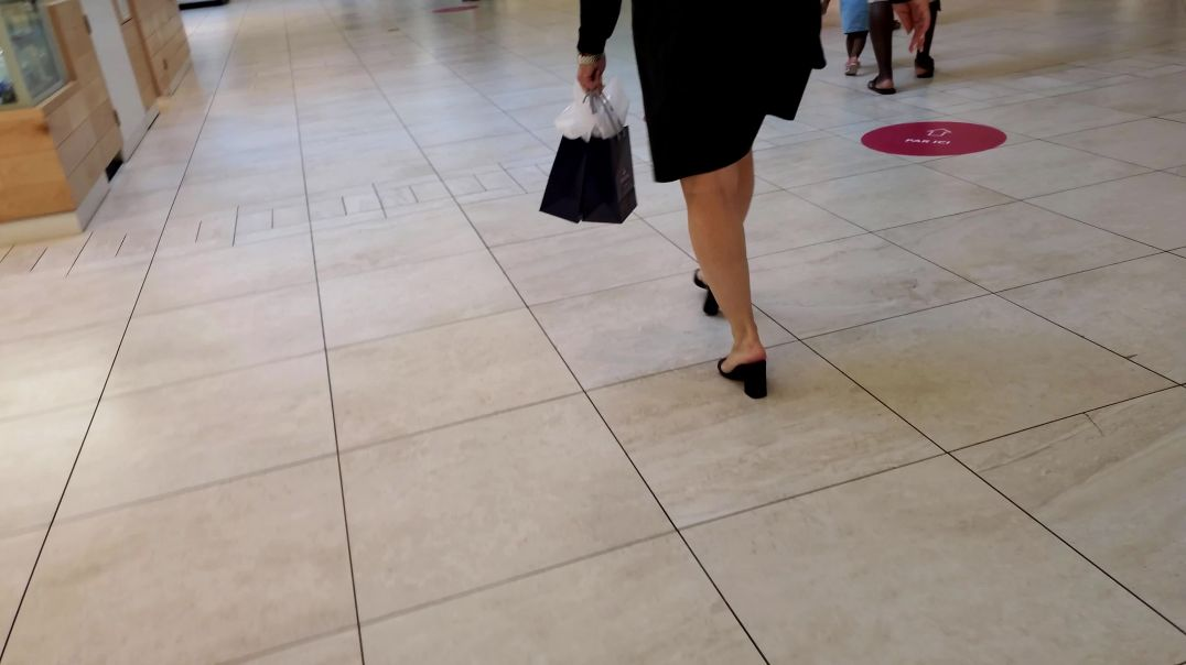 Blonde lady shopping in block heeled mules