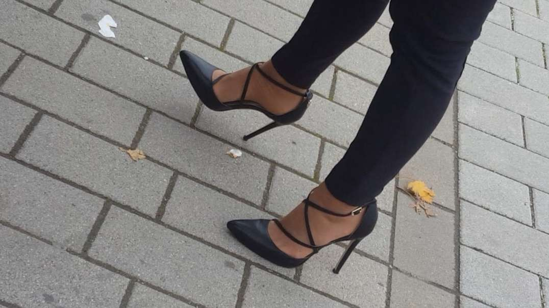 Sexy black heels waitin' for the bus